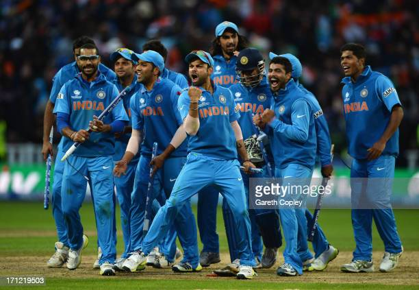 Virat Kohli of India celebrates victory with team mates during the ICC Champions Trophy Final between England and India at Edgbaston on June 23 2013...