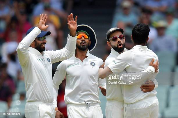 Virat Kohli of India celebrates with his team mates during day five of the First Test match in the series between Australia and India at Adelaide...