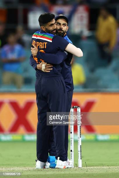 Virat Kohli of India celebrates with Jasprit Bumrah of India after winning game three of the One Day International series between Australia and India...