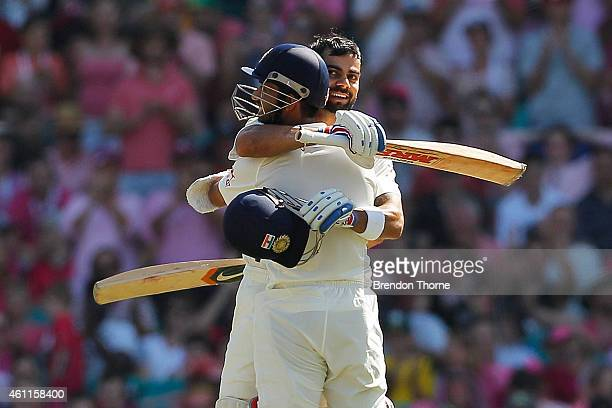 Virat Kohli of India celebrates with team mate Ajinya Rahane after scoring his century during day three of the Fourth Test match between Australia...