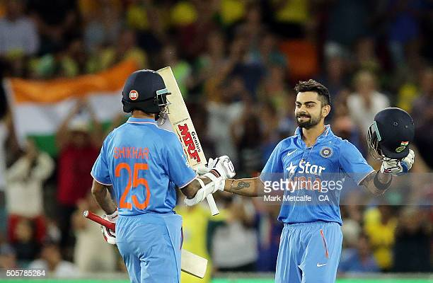 Virat Kohli of India celebrates with team mate Shikhar Dhawan after scoring a century during the Victoria Bitter One Day International match between...