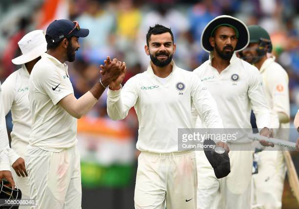 Virat Kohli of India celebrates with team mates after getting the final wicket and winning the test match during day five of the First Test match in...