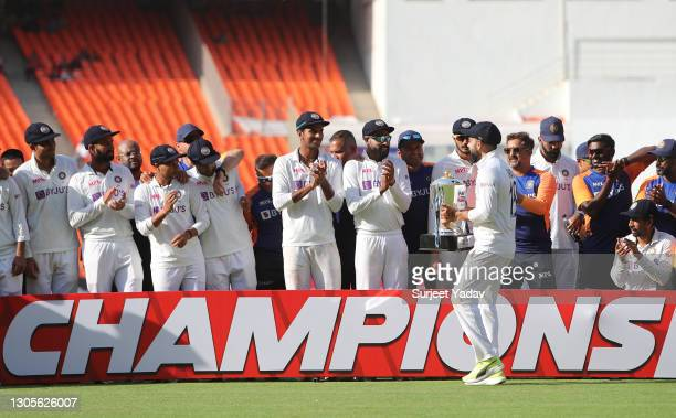 Virat Kohli of India celebrates with teammates after victory on Day Three of the 4th Test Match between India and England at the Narendra Modi...