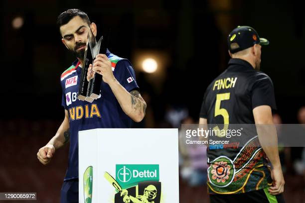 Virat Kohli of India collects the T20 Trophy following game three of the Twenty20 International series between Australia and India at Sydney Cricket...