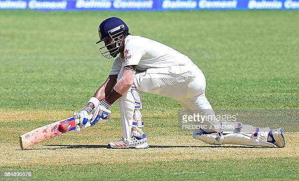 Virat Kohli of India connects for a run off West Indies bowler Roston Chase on day 2 of the 2nd Test between India and the West Indies on July 31...