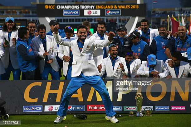 Virat Kohli of India dances in celebration during the victory ceremony following India's 5 run victory in the ICC Champions Trophy Final match...