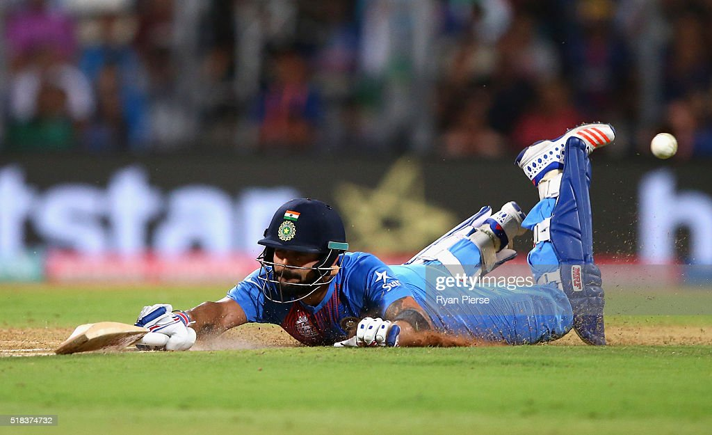 Virat Kohli of India dives to make his ground during the ICC World Twenty20 India 2016 Semi Final match between West Indies and India at Wankhede Stadium on March 31, 2016 in Mumbai, India.