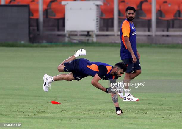 Virat Kohli of India dives to take a catch at Narendra Modi Stadium on March 08, 2021 in Ahmedabad, India.