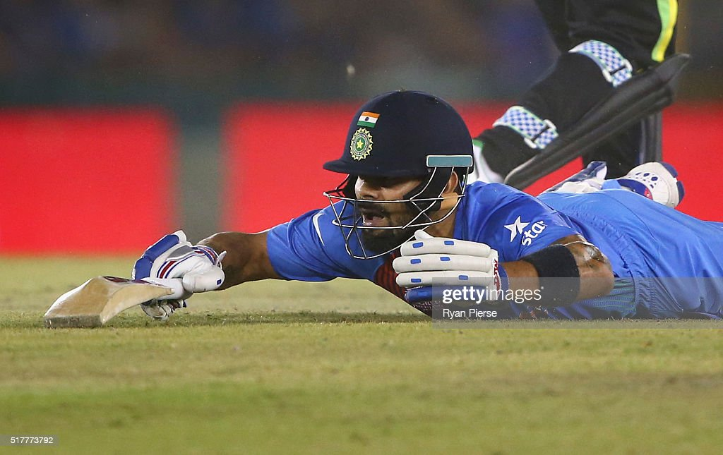 Virat Kohli of India dives while completing a run during the ICC WT20 India Group 2 match between India and Australia at IS Bindra Stadium on March...