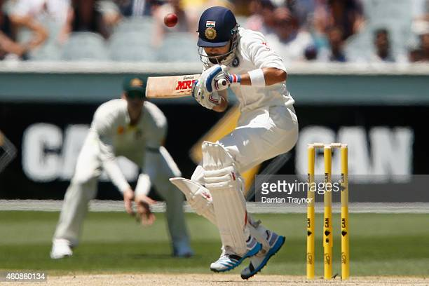 Virat Kohli of India evades a Mitchell Johnson of Australia bouncer during day three of the Third Test match between Australia and India at Melbourne...