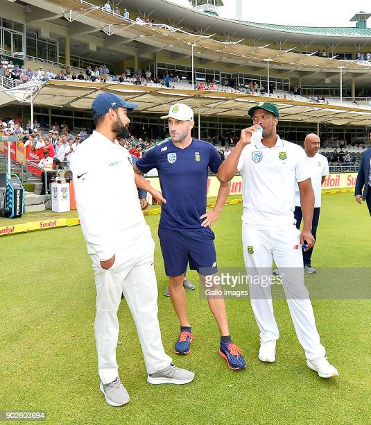Virat Kohli of India Faf du Plessis of South Africa and Vernon Philander of South Africa chats after day 4 of the 1st Sunfoil Test match between...