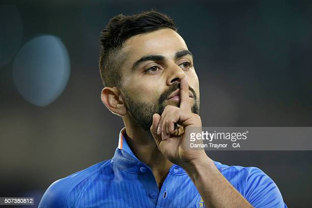 Virat Kohli of India gestures to Australian fans to be quiet after India took the wicket of Glenn Maxwell of Australia during the International...