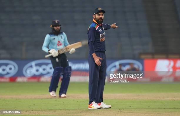Virat Kohli of India gives instructions to their side during the 3rd One Day International match between India and England at MCA Stadium on March...