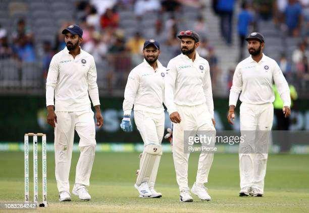 Virat Kohli of India has words with Tim Paine of Australia at stumps during day three of the second match in the Test series between Australia and...