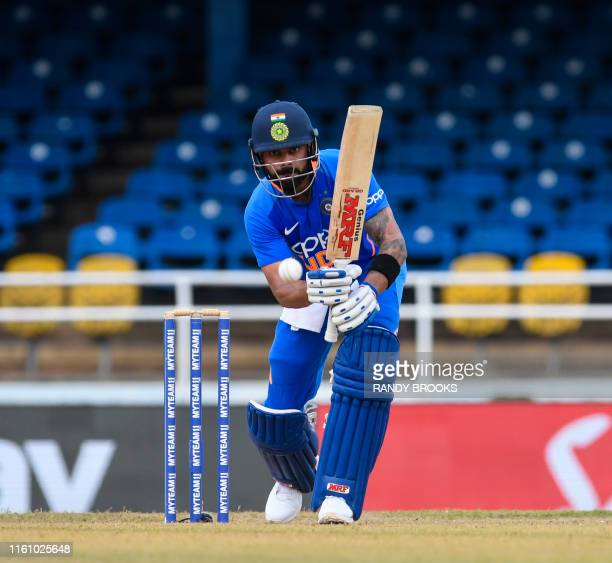 Virat Kohli of India hits 4 during the 2nd ODI match between West Indies and India at Queens Park Oval in Port of Spain, Trinidad and Tobago, on...