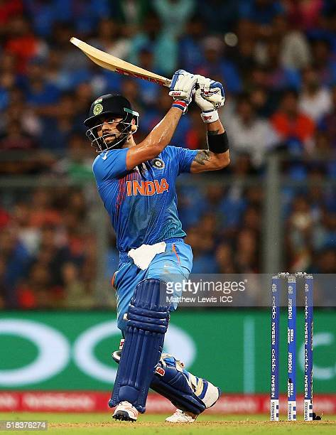Virat Kohli of India hits a six during the ICC World Twenty20 India 2016 SemiFinal match between West Indies and India at the Wankhede Stadium on...