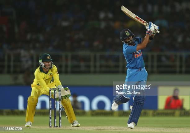 Virat Kohli of India hits out during game one of the T20I Series between India and Australia at ACA-VDCA Stadium on February 24, 2019 in...