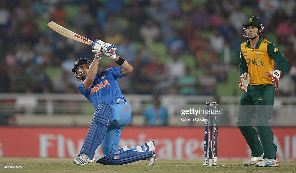 Virat Kohli of India hits out for six runs during the ICC World Twenty20 Bangladesh 2014 semi final between India and South Africa at Sher-e-Bangla Mirpur Stadium on April 4, 2014 in Dhaka, Bangladesh.