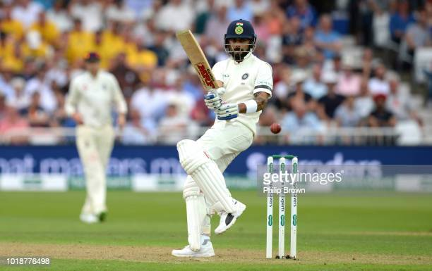 Virat Kohli of India hits out watched by Jonny Bairstow during the 3rd Specsavers Test Match between England and India at Trent Bridge on August 18,...
