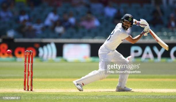 Virat Kohli of India hits the ball and is caught by Cameron Green during day three of the First Test match between Australia and India at Adelaide...