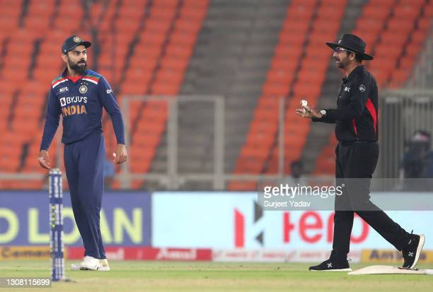 Virat Kohli of India in conversation with the umpire following the wicket of Jos buttler during the 5th T20 International between India and England...
