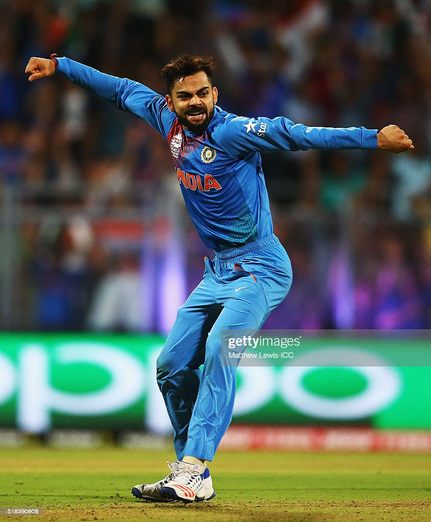Virat Kohli of India is celebrates the wicket of Johnson Charles of the West Indies, after he was caught by Rohit Sharma of India during the ICC World Twenty20 India 2016 Semi-Final match between West Indies and India at the Wankhede Stadium on March 31, 2016 in Mumbai, India.