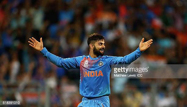 Virat Kohli of India is celebrates the wicket of Johnson Charles of the West Indies after he was caught by Rohit Sharma of India during the ICC World...