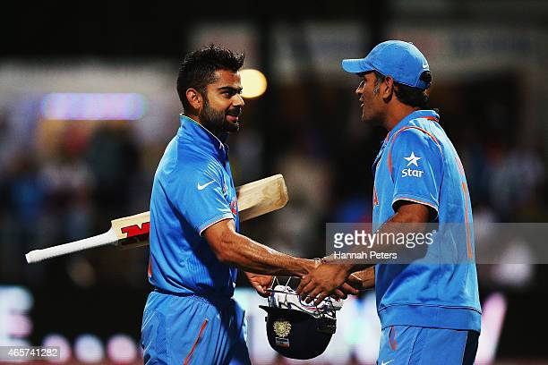 Virat Kohli of India is congratulated by MS Dhoni of India after winning the 2015 ICC Cricket World Cup match between Ireland and India at Seddon...