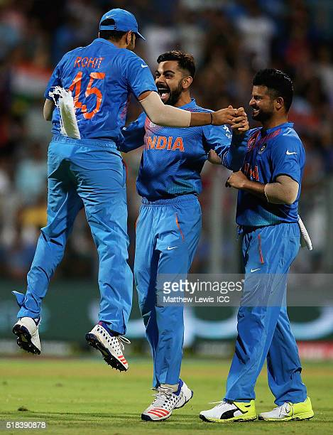 Virat Kohli of India is congratulated by Rohit Sharma of India on the wicket of Johnson Charles of the West Indies during the ICC World Twenty20...