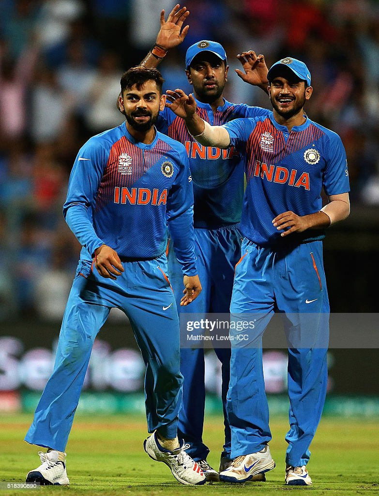 Virat Kohli of India is congratulated by team mates on the wicket of Johnson Charles of the West Indies, after he was caught by Rohit Sharma of India during the ICC World Twenty20 India 2016 Semi-Final match between West Indies and India at the Wankhede Stadium on March 31, 2016 in Mumbai, India.