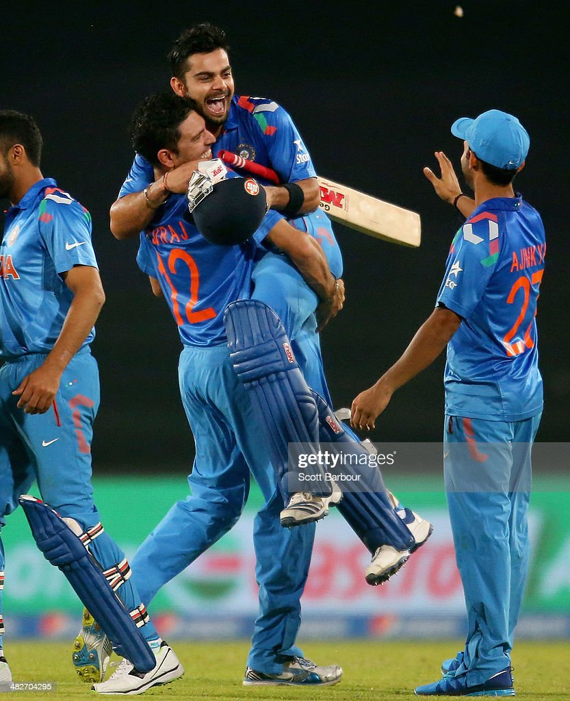 Virat Kohli of India is hugged by Yuvraj Singh after he hit the winning runs as India won the ICC World Twenty20 Bangladesh 2014 2nd Semi-Final match between India and South Africa at Sher-e-Bangla Mirpur Stadium on April 4, 2014 in Dhaka, Bangladesh.