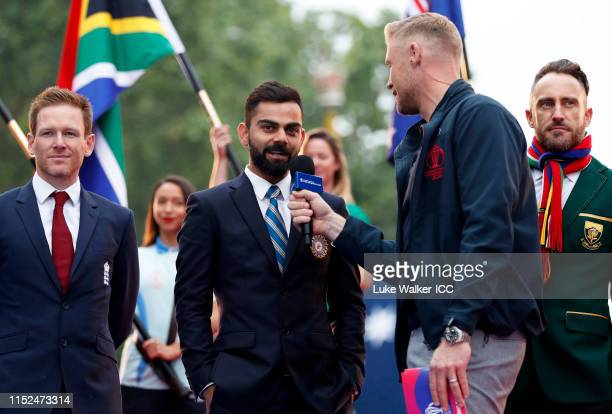 Virat Kohli of India is interviewed by Andrew Flintoff during the ICC Cricket World Cup 2019 Opening Party at The Mall on May 29, 2019 in London,...