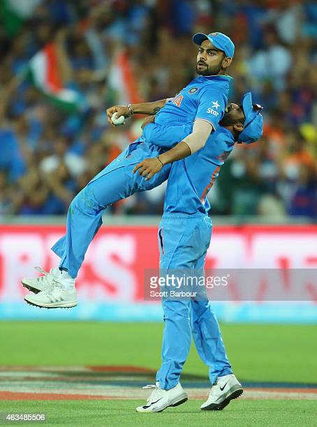 Virat Kohli of India is lifted in the air by Ravindra Jadeja after taking a catch to dismiss Shahid Afridi of Pakistan during the 2015 ICC Cricket...