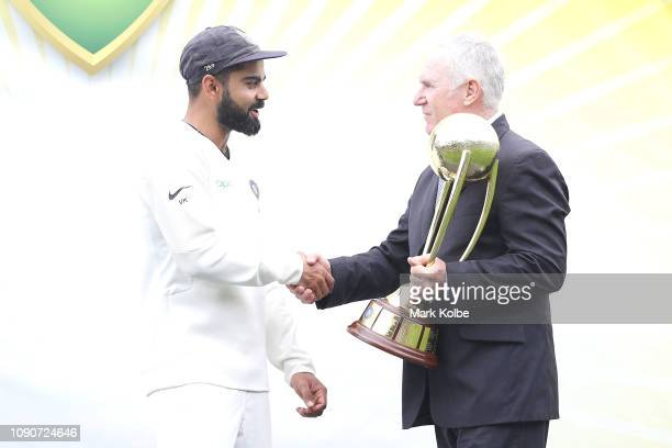 Virat Kohli of India is presented with the Border–Gavaskar Trophy by Allan Border after India's 2-1 series win after day five of the Fourth Test...