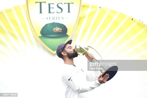 Virat Kohli of India kisses the Border–Gavaskar Trophy after India's 21 series win after day five of the Fourth Test match in the series between...