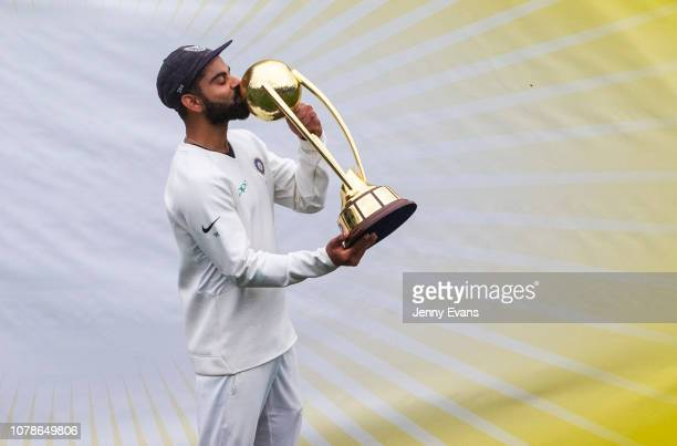 Virat Kohli of India kisses the BorderGavaskar Trophy as he celebrates India's 2-1 series win after day five of the Fourth Test match in the series...