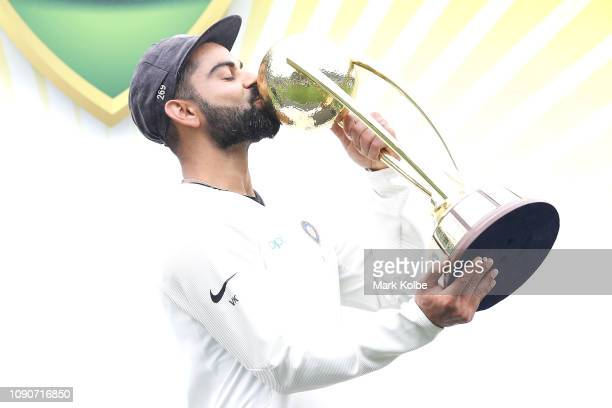 Virat Kohli of India kisses the Border–Gavaskar Trophy as he celebrates India's 21 series win after day five of the Fourth Test match in the series...