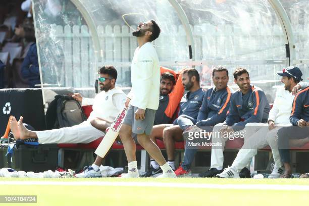 Virat Kohli of India laughs with team mates on the team bench during day two of the four day International Tour Match between the Cricket Australia...