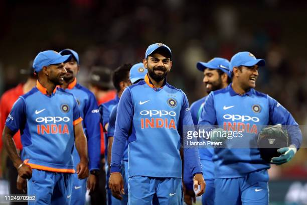 Virat Kohli of India leads his team off after winning game two of the One Day International Series between New Zealand and India at Bay Oval on...