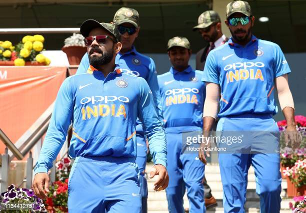Virat Kohli of India leads his team out during game three of the One Day International series between India and Australia at JSCA International...