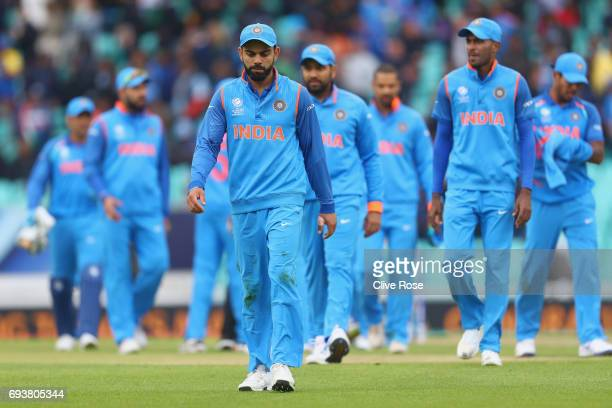 Virat Kohli of India leads the team off the field after being defeated by Sri Lanka in the ICC Champions trophy cricket match between India and Sri...