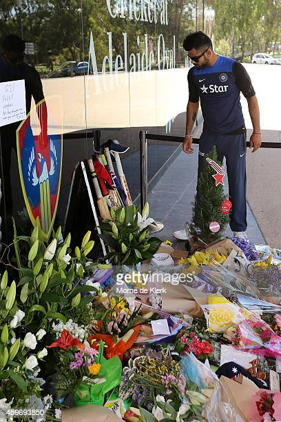 Virat Kohli of India leaves a bat and cap at a memorial for Phil Hughes outside the Adelaide Oval during an India training session at Adelaide Oval...