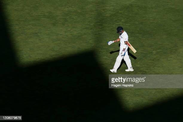 Virat Kohli of India leaves the field after being dismissed during day three of the First Test match between New Zealand and India at Basin Reserve...