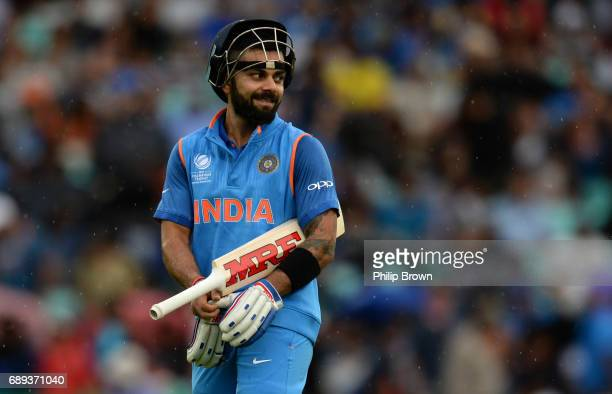 Virat Kohli of India leaves the field because of rain during the ICC Champions Trophy Warmup match between India and New Zealand at the Kia Oval...