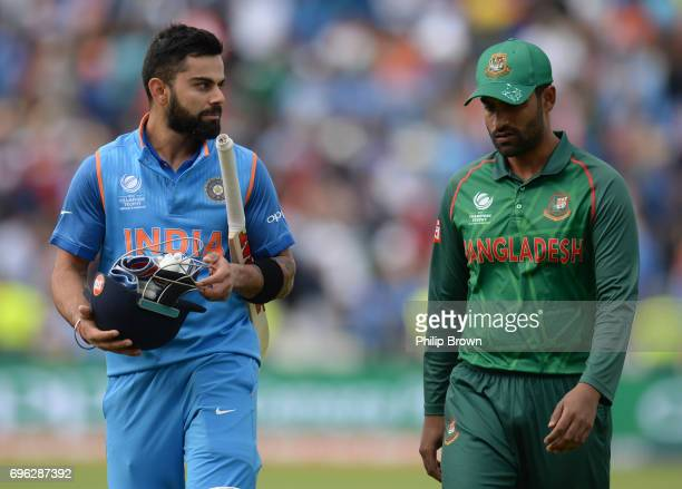 Virat Kohli of India leaves the field with Tamim Iqbal after India won the ICC Champions Trophy match between Bangladesh and India at Edgbaston...