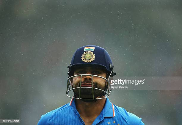 Virat Kohli of India leaves the ground after rain stopped play during the One Day International match between Australia and India at Sydney Cricket...