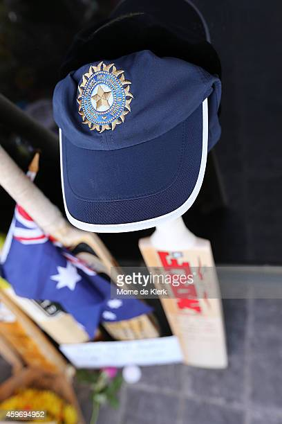 Virat Kohli of India left a bat and cap at a memorial for Phil Hughes outside the Adelaide Oval during an India training session at Adelaide Oval on...
