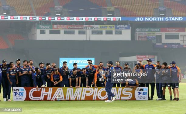 Virat Kohli of India lifts the trophy with teammates after victory in the 5th T20 International between India and England at Narendra Modi Stadium on...