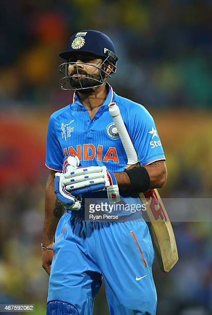 Virat Kohli of India looks dejected after being dismissed by Mitchell Johnson of Australia during the 2015 Cricket World Cup Semi Final match between...