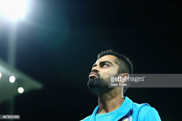 Virat Kohli of India looks dejected as he leaves the field after defeat during the 2015 Cricket World Cup Semi Final match between Australia and...